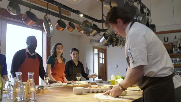 Chef teaching his students how to knead pasta Royalty-free stock video