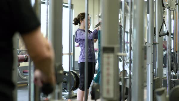 Mature woman pulldown exercising with a trainer Royalty-free stock video