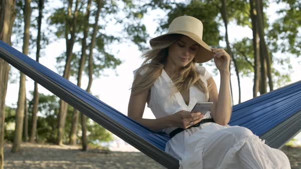 A woman sitting in a hammock Royalty-free stock video