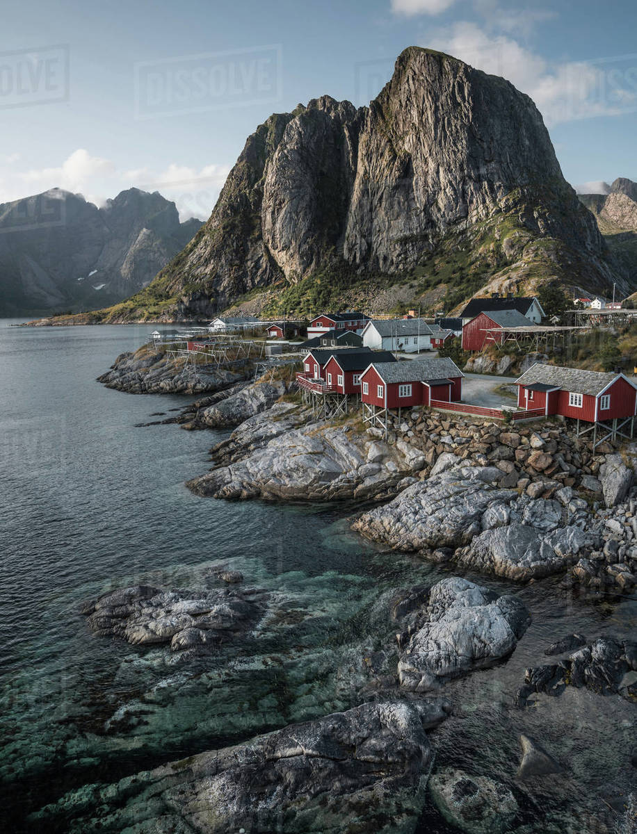 View of houses by sea with mountains in background, Lofoten, Norway Royalty-free stock photo