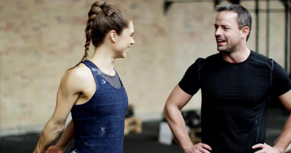 Fit man and woman in gym, team exercsing in  group, talking and laughing Royalty-free stock video