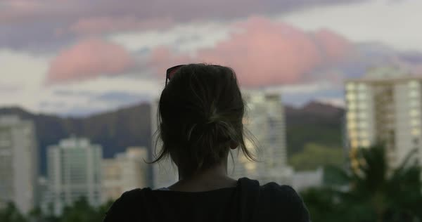 Hand-held shot of a woman enjoying view of a city in Hawaii Royalty-free stock video