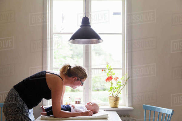 Sweden, Mother playing with daughter (0-1 months) Royalty-free stock photo
