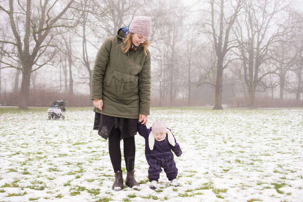 Sweden, Skane, Malmo, Young woman with daughter (12-17 months) in park Royalty-free stock photo
