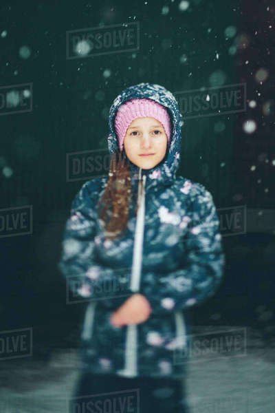 Sweden, Blekinge, Portrait of girl (10-11) wearing jacket in snowfall Royalty-free stock photo