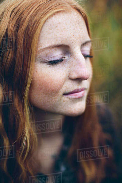 Sweden, Portrait of girl (16-17) with eyes closed Royalty-free stock photo