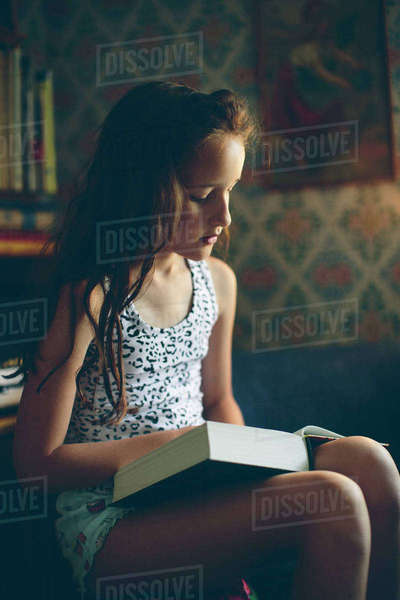 Sweden, Smaland, Mortfors, Portrait of reading girl (10-11) Royalty-free stock photo