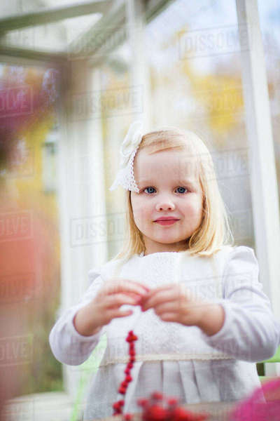Finland, Girl (2-3) stringing beads in house Royalty-free stock photo