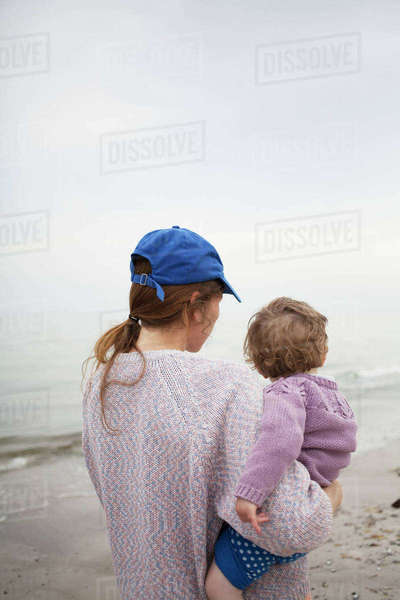 Sweden, Skane, Osterlen, Mother carrying daughter (2-3) on beach Royalty-free stock photo