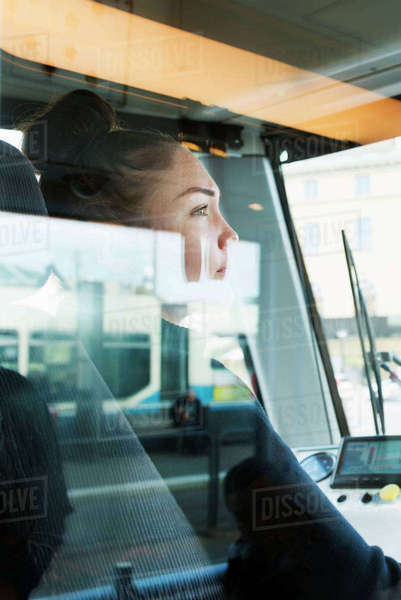 Sweden, Vastra Gotaland, Female tram driver seen through window Royalty-free stock photo