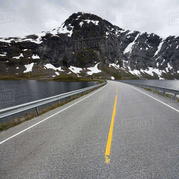 Norway, Stryn, Langevatnet, Empty road on lake in mountains Royalty-free stock photo