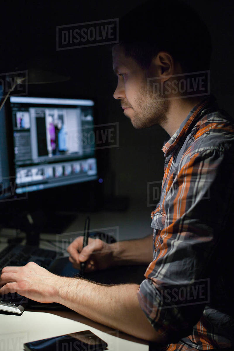 Sweden, Design professional working on computer at night Royalty-free stock photo