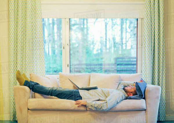 Finland, Man resting on sofa Royalty-free stock photo