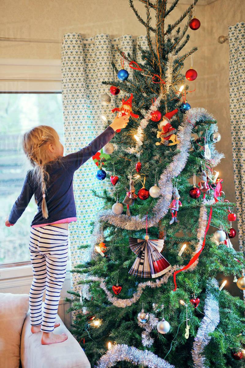 Finland Christmas Decorations.Finland Girl 4 5 Decorating Christmas Tree Stock Photo
