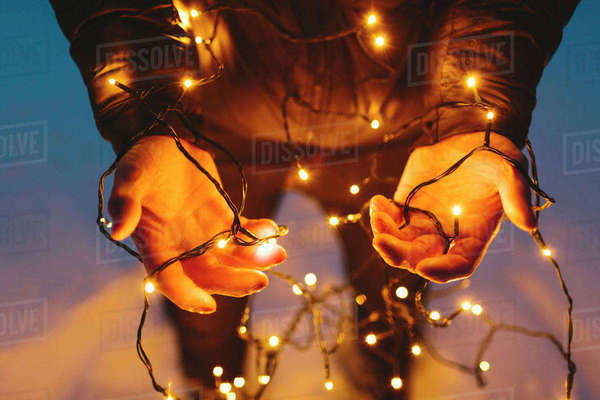 Finland, Jyvaskyla, Saakoski, Young man holding Christmas lights Royalty-free stock photo