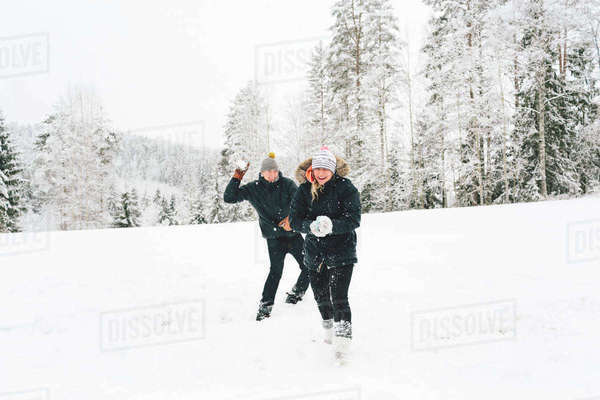Finland, Jyvaskyla, Saakoski, Young couple having snowball fight Royalty-free stock photo