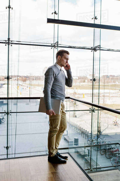 Finland, Young businessman talking on phone in office building Royalty-free stock photo