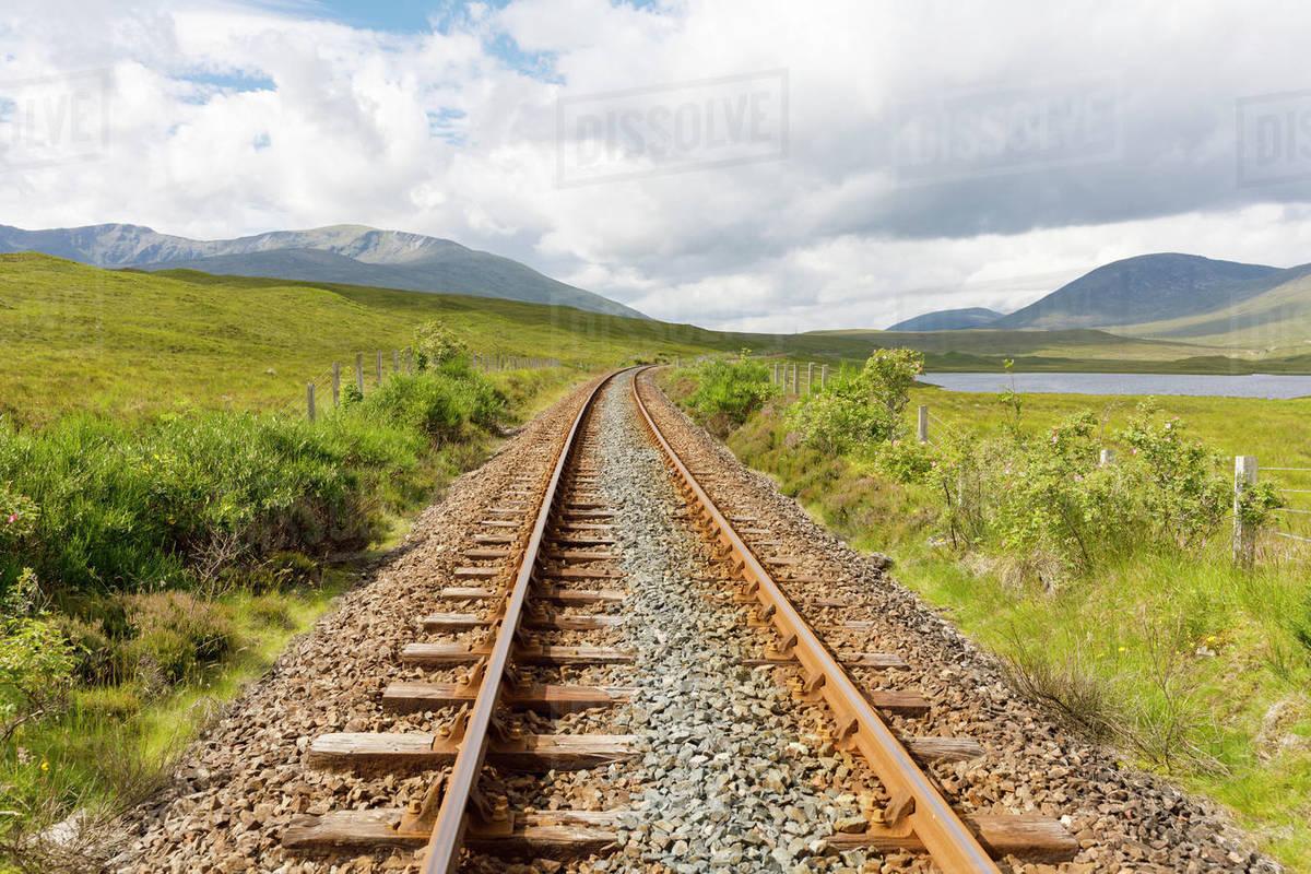 Railway tracks convergence stock photo. Image of lines