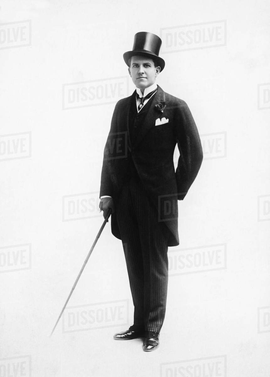 Portrait of a man in a top hat and morning suit holding a cane ... 5284c754b68
