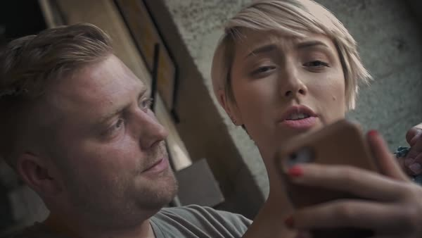 Slow motion shot of a couple making a video call with a smartphone Royalty-free stock video