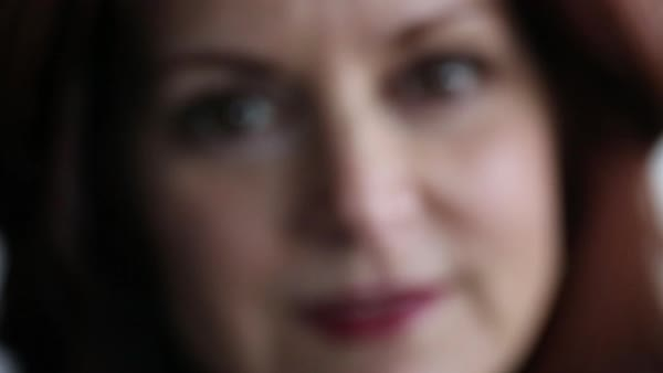 Rack focus portrait of a woman looking at camera Royalty-free stock video