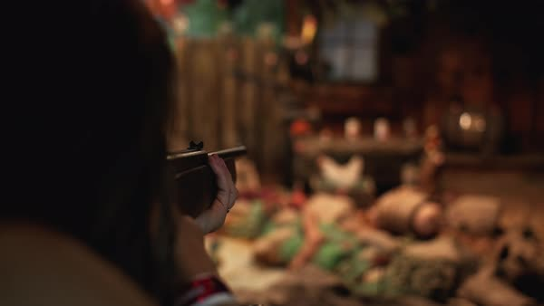 Hand-held shot of a woman shooting in an amusement park game Royalty-free stock video