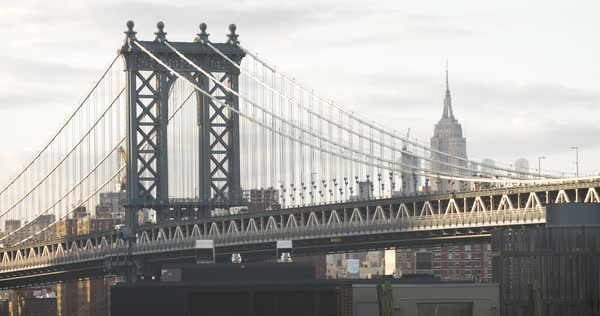 A closeup shot of traffic passing over New York City's Manhattan Bridge at sunset Royalty-free stock video