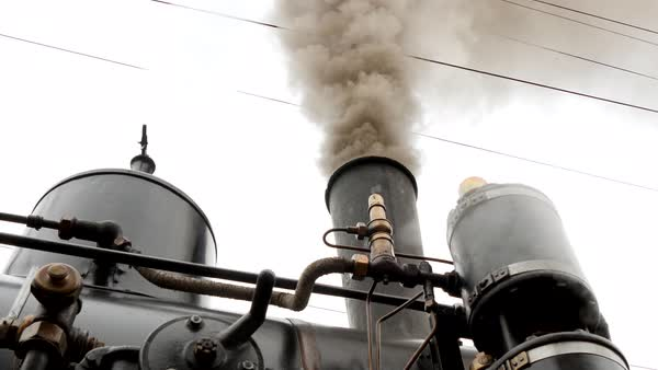 Old historical steam engine train locomotive puffing smoke out of chimney Royalty-free stock video