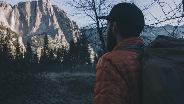 A hiker looks at yosemite falls Royalty-free stock video