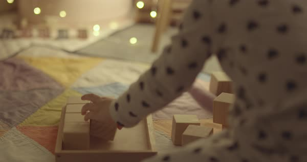 Hand-held shot of a little girl arranging toy blocks Royalty-free stock video