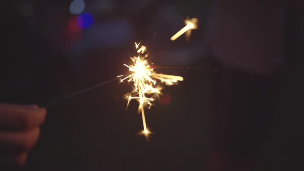 Hand-held shot of a person holding a burning sparkler Royalty-free stock video