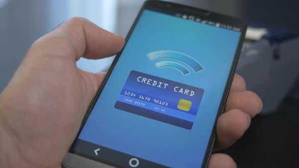 Sending payment with smartphone over terminal at a store. Virtual credit card. Royalty-free stock video