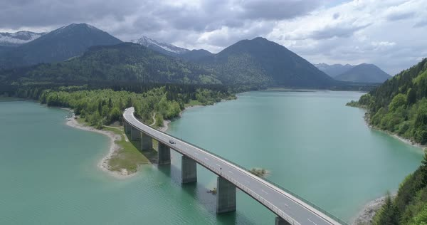 Bridge over a lake in the mountains Royalty-free stock video