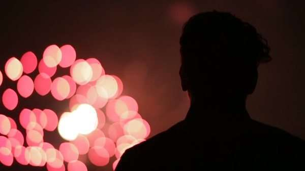 Close up of man watching fireworks Royalty-free stock video