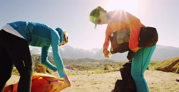 Slow motion shot of two female hikers preparing to set up a tent Royalty-free stock video