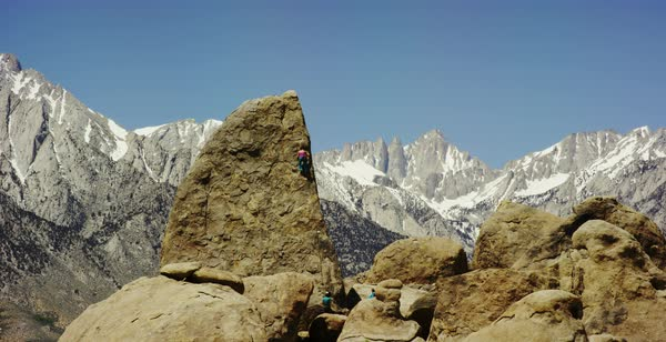 Static shot of a woman climbing up a rock in Alabama Hills Royalty-free stock video