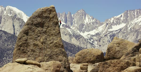 Static shot of a woman climbing a rock in Alabama Hills Royalty-free stock video
