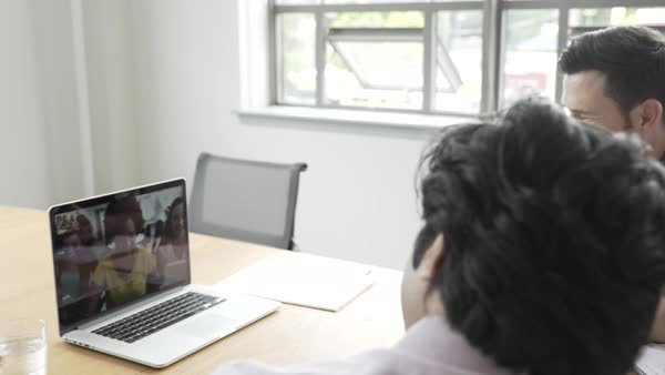 Hand-held shot view of a group of office workers having a video conference Royalty-free stock video