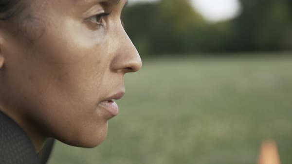 Hand held shot of a woman's face after working out in a park Royalty-free stock video