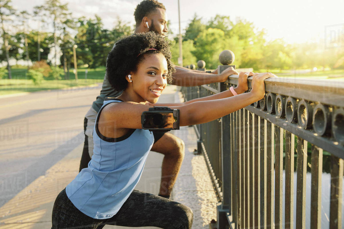 Couple preparing for running stretching at waterfront Royalty-free stock photo