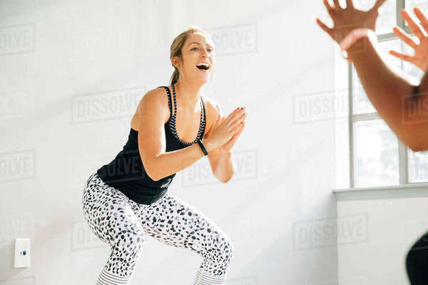 Instructor leading exercise class in studio Royalty-free stock photo