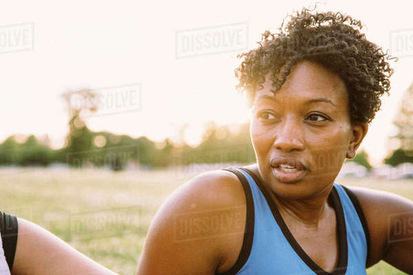 Portrait of woman in field after workout Royalty-free stock photo