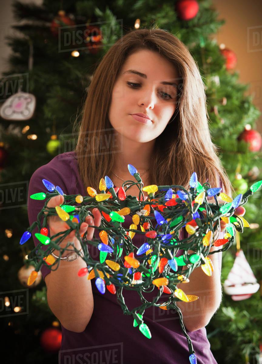 caucasian woman holding tangled christmas lights - Tangled Christmas Lights