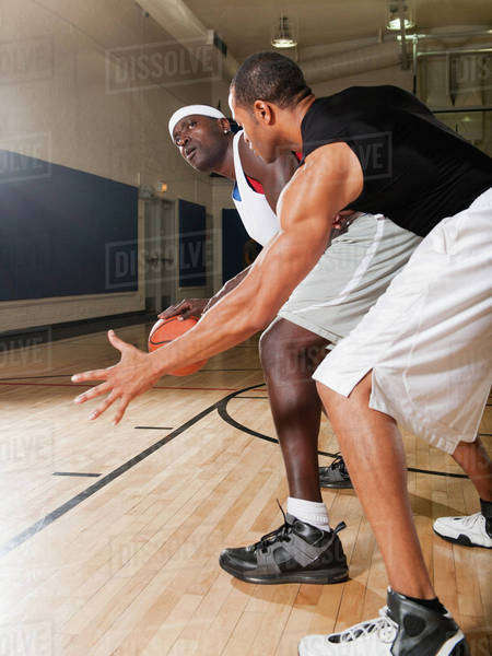 Men playing basketball on basketball court Royalty-free stock photo