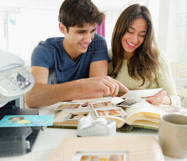 Couple looking at photographs together Royalty-free stock photo
