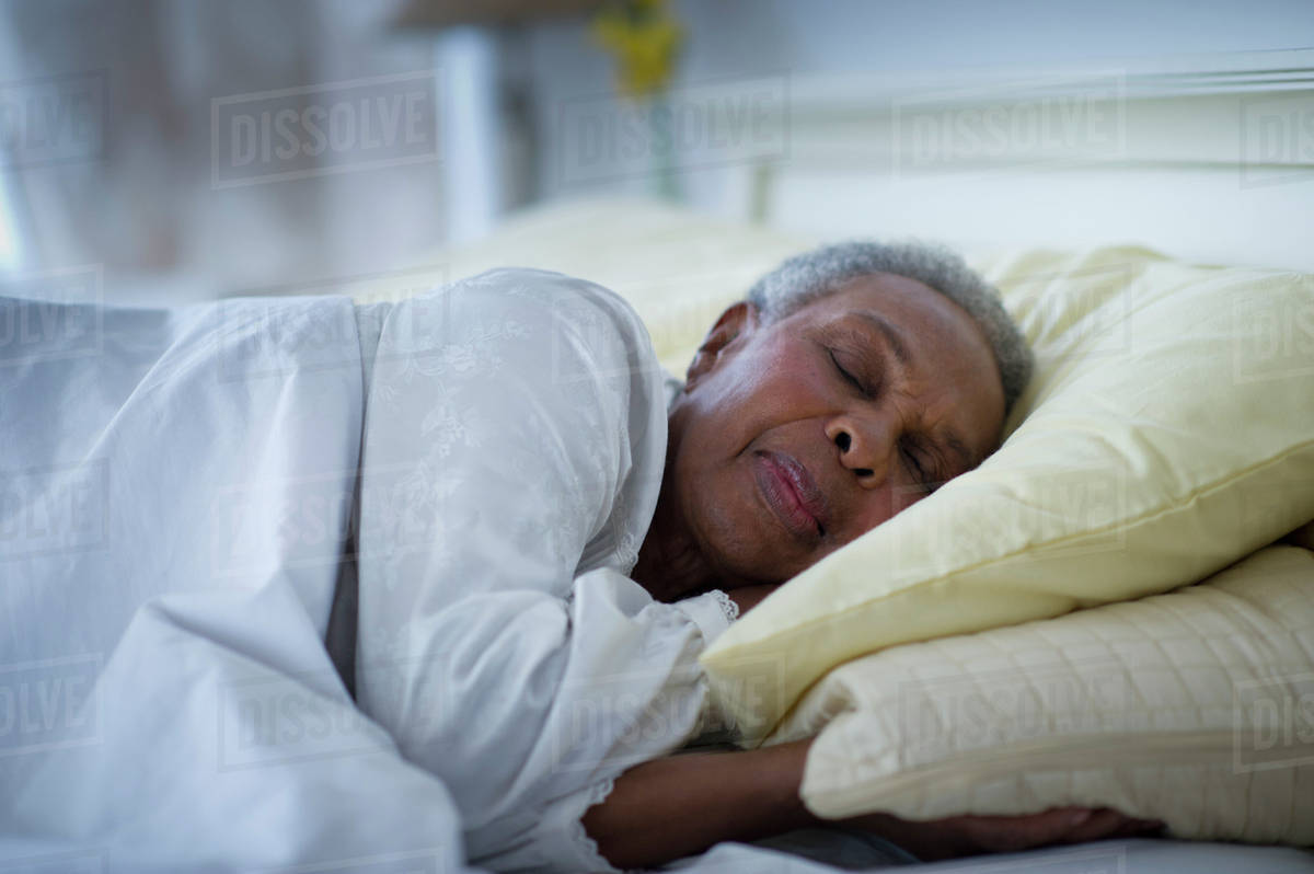 Black Woman Sleeping In Bed - Stock Photo - Dissolve-1140