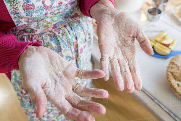 Close up of flour on hands of older Caucasian woman Royalty-free stock photo