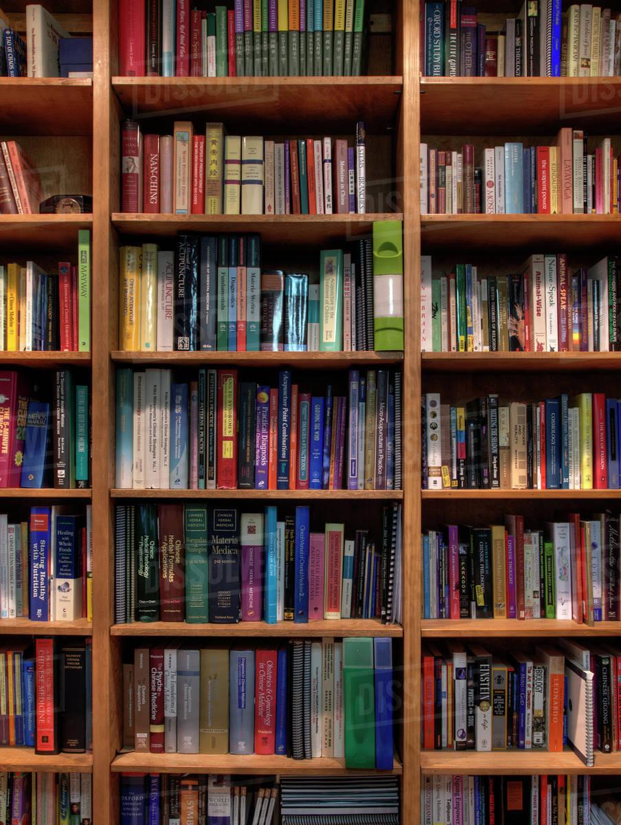 Books organized in bookshelves Books organized in
