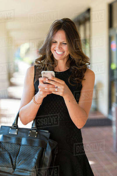 Caucasian woman texting on cell phone Royalty-free stock photo