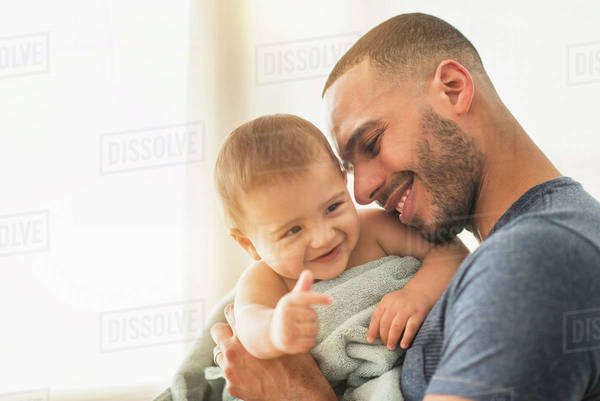 Father drying baby son with towel after bath Royalty-free stock photo